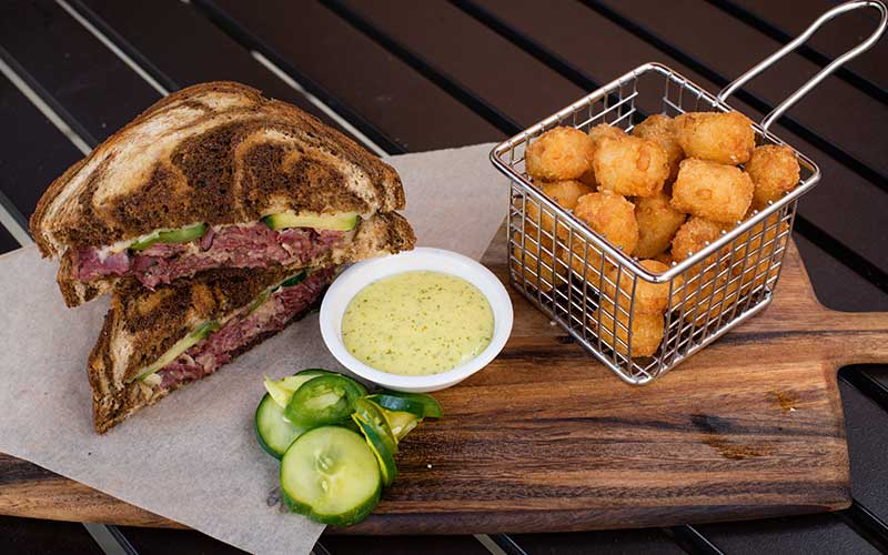 Pastrami Sandwich and Tater Tots